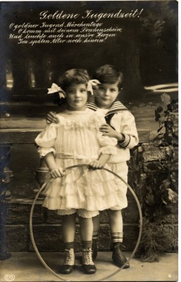 Vintage Child fashion in Germany. Twins costumes. Retro children clothing. Sailor suit.