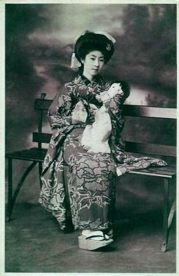 Traditional Japan national costume. Japanese women`s clothing. Geisha, Maiko in antique kimono.