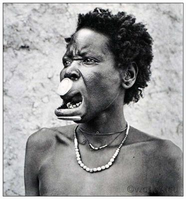 African Tribe from Equatorial Africa Cameroon and Chad. Traditional Musgu, Mulwi woman costume. Lip Plate Piercing, jewlery. photogravure