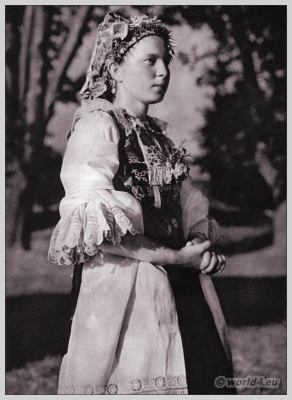 Young girl from Madunice in Slovakian national costume. Beautiful embroidery design