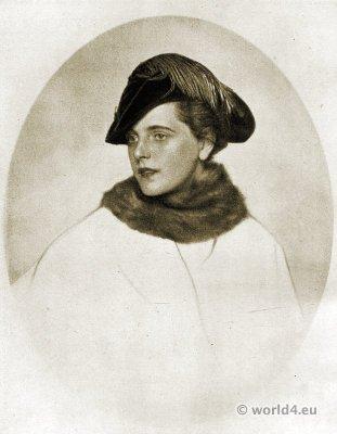 Autumn hat fashion 1915, Berlin. Bicorn hat of dark green velvet with cocks neck feather decoration