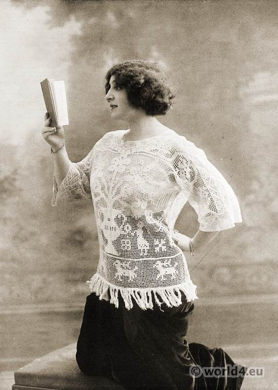German women fashion 1913. Blouse in lace netting with attached lap.