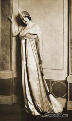 Paul Poiret - Paris 1912. Evening dress in white satin. Art-nouveau fashion. Vintage Haute couture costume.