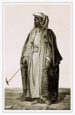 Traditional Arabian dress. Arab burnus costume. Bedouin Caftan and Turban.