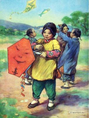 Chinese children. Chinese children costumes. Flying Kites