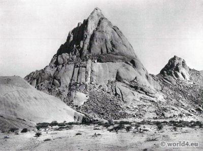 Archaen rock cones in the Namib Desert. African botanic dessert plants. Africa landscape