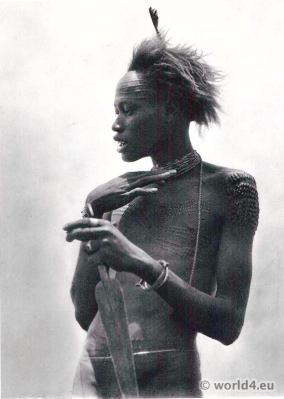 African tribe Nuer warrior with tribal mark on forehead.