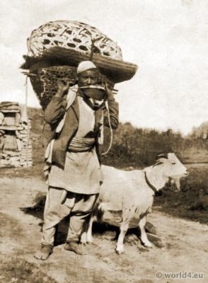 Gurkha Farmer with baskets and goat in Nepal