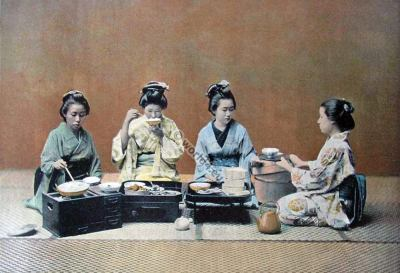 Japan women in a dining room. Traditional Japan costumes. Old japanese kimonos.