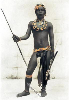 Zulu warrior dress and weapons. Traditional South Africa native costume.