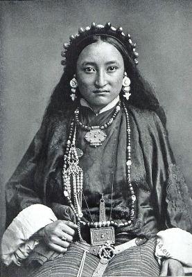 Lama woman costume. Amulet. Tibet dress. Tibetan national costume.