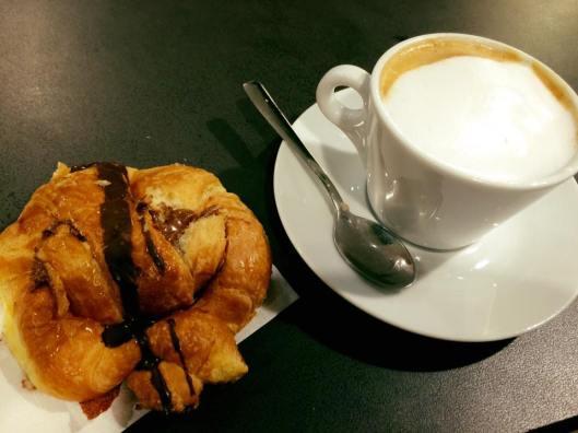 Italian breakfast at Rome-Fiumicino Airport: cornetto al cioccolato e cappucino