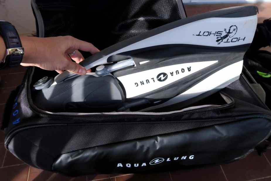 Aqua !Lung Hot Shot scuba diving fins going into a carry-on suitcase