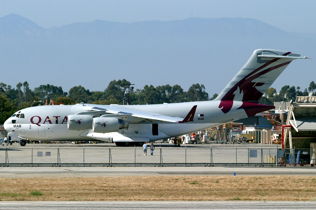 No, Qatar Airways will no be using the new Boeing C-17A Globemaster III to fly passengers to Europe.  However the first two new C-17As have been painted at Long Beach pending delivery.  One is painted in full Qatar Airways' colors.  Copyright Photo: Michael Carter.
