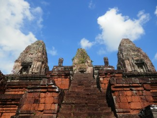 We climbed up some steep steps to the upper platform where the five towers sit. Quite a view from there, and one of our favorite temples.