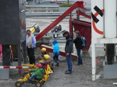Children play at the construction zone, under the watchful eye of their parents of course.