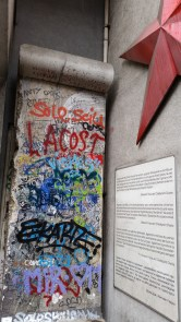Part of the Berlin Wall marks the front of the Checkpoint Charlie Museum.