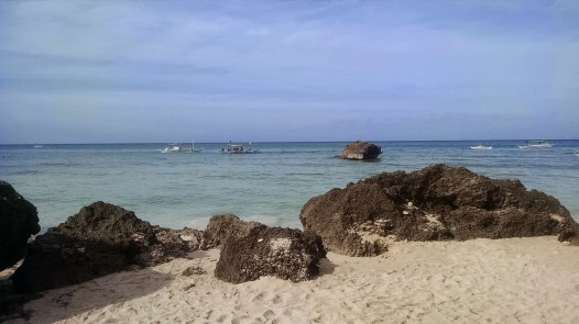 The rocky shore of Diniwid Beach. The sand is still top-notch though.