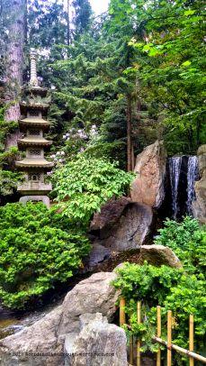 A pagoda and waterfall at the Nishinomiya Tsutakawa Japanese Garden.