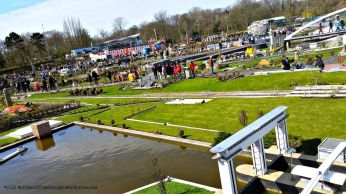 The grounds of Madurodam. At the foreground, a working water lock.