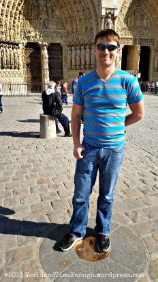 David stands at the kilometer zero of France