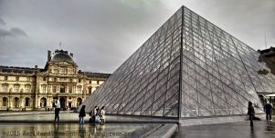 The famous, eye-catching pyramid of the Louvre, blending modern and ancient.