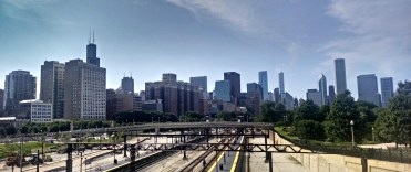 Awesome skyline view over some train tracks