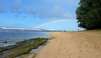 A rainbow at Ke'e Beach. The shore is great, but the water is rocky.