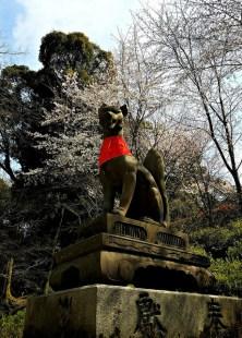 Inari's foxes guard the shrine.