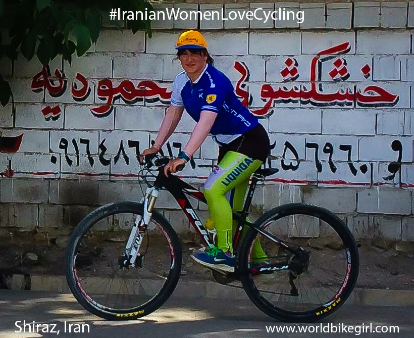 Photo of me cycling in Iran with hashtag Iranian Women Love Cycling.