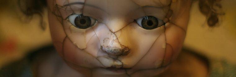 broken child's doll put together