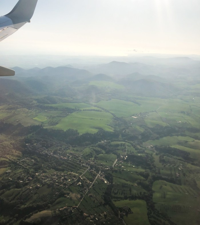 Travel photos out of airplane italy sicily green landscape