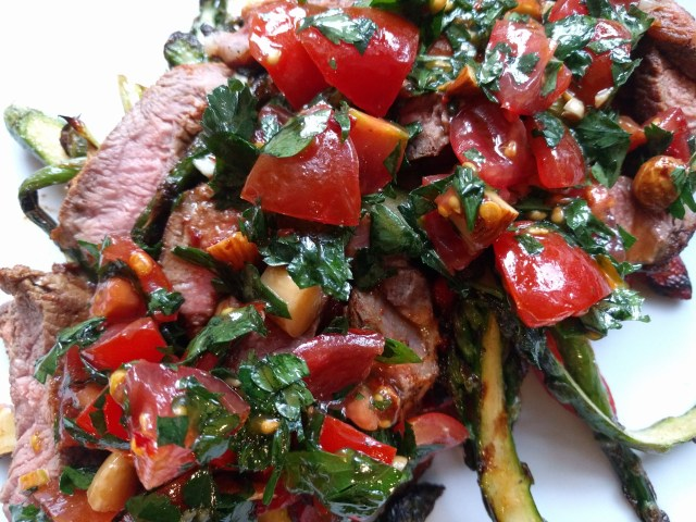 Seared steak with roast peppers, asparagus and salbitxada sauce