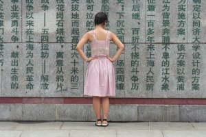 Girl at wall in China.jpg