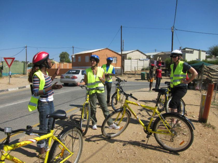 Tour guide Anna prepares group for bike tour through Katutura, Namibia. Photo: Chris Chesak