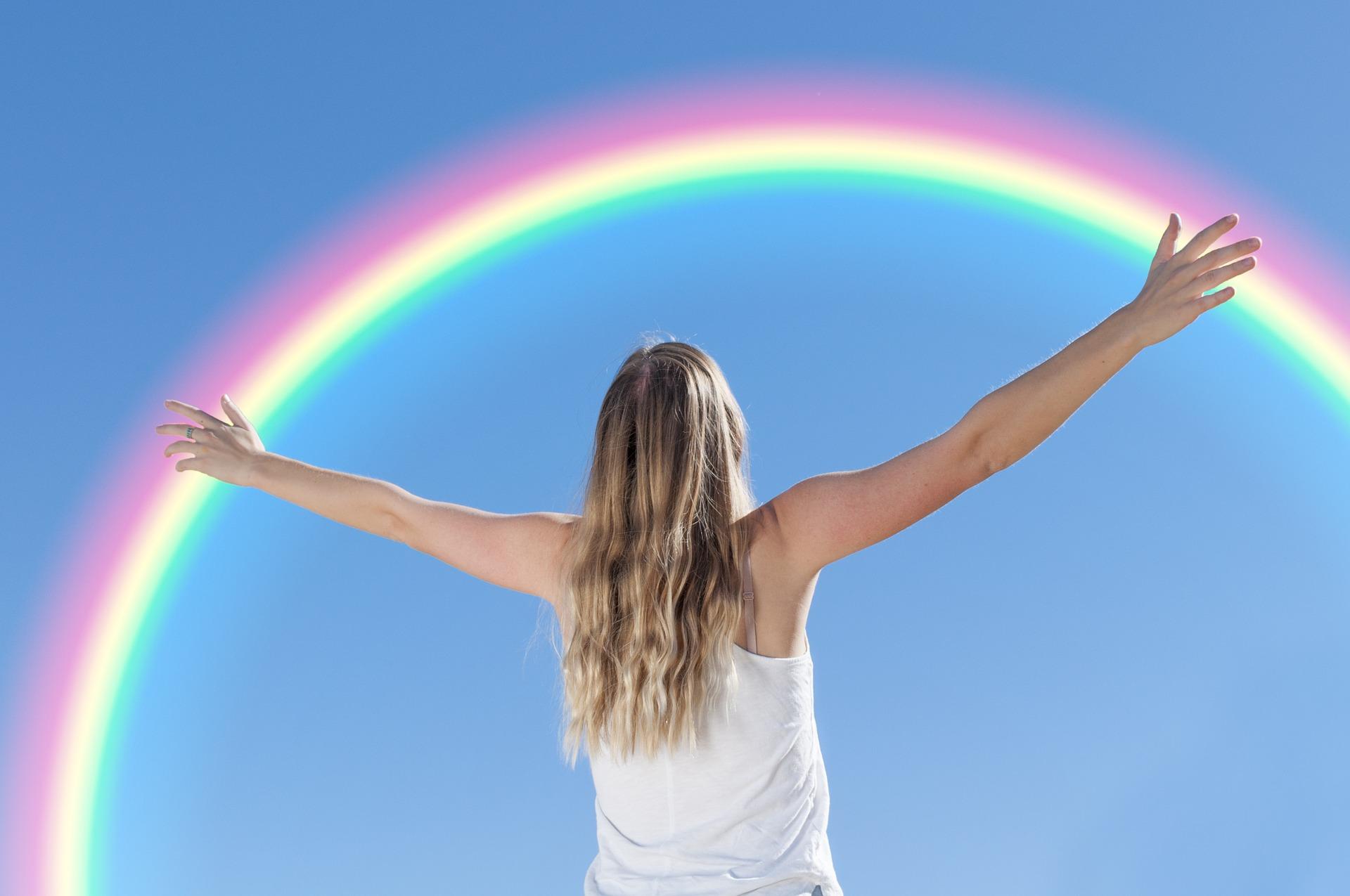 Woman celebrating a rainbow