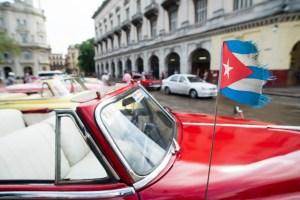Cuban car with flag in Havana.