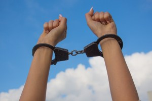 Handcuffed with sky background