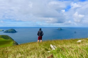 Derek Cullen overlooking the habor on the Great Blasket Island in Irleland