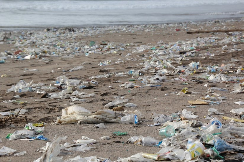 Plastic waste and garbage covering a beach