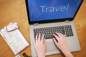 Travel on Computer with hands