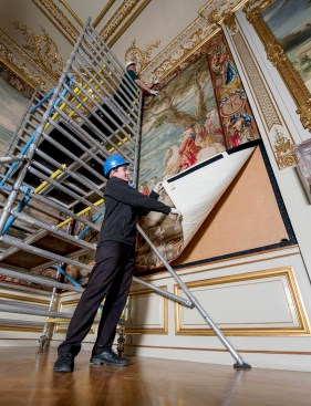©MARK HEMSWORTH. 12/04/16. BLENHEIM PALACE, OXFORDSHIRE. Rehanging a tapestry thats has been cleaned on the wall of one of the state rooms in Blenheim Palace. Photo credit : MARK HEMSWORTH