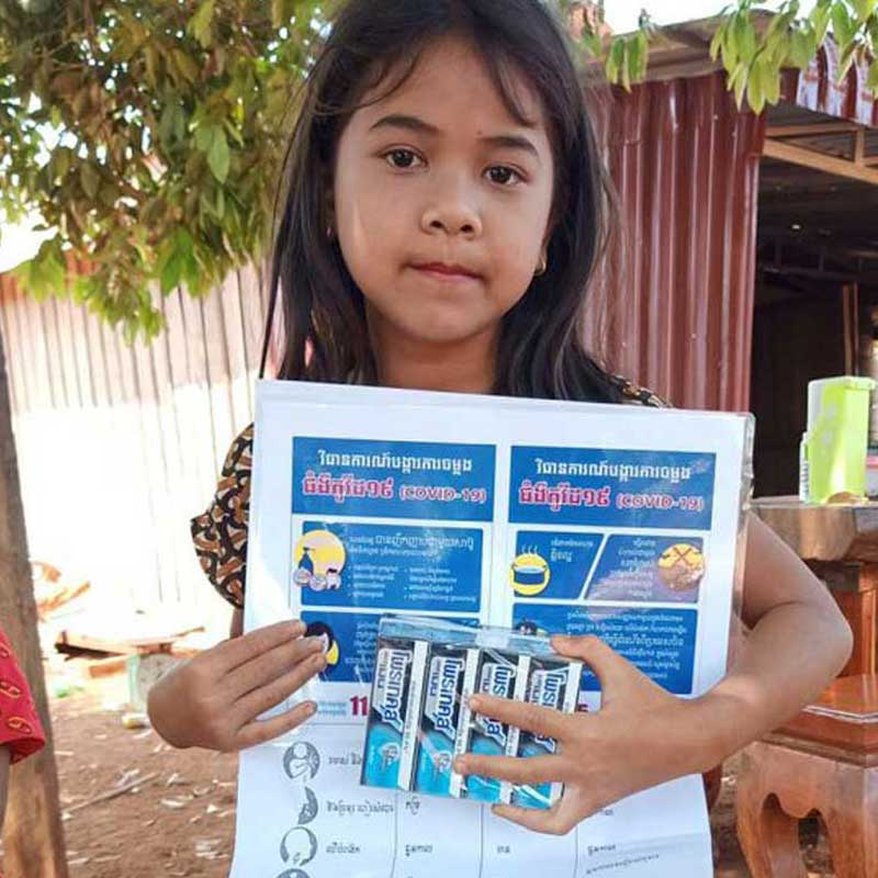 Girl holding soap and handwashing instructions
