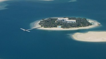 Une rare île de The World habitée