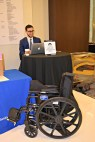 A manual wheelchair stands in front of the Hill Visits desk