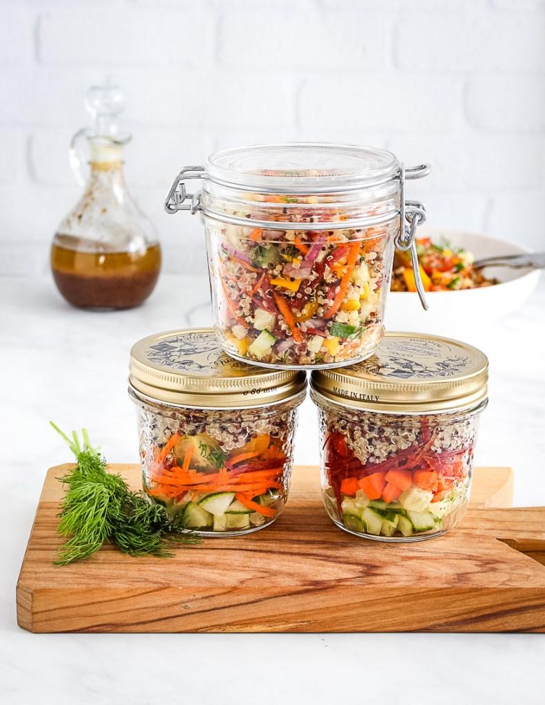 tri color quinoa salad in a jar