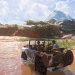 uncharted 4 characters ride through a tributary in madagascar in their 4x4 vehicle