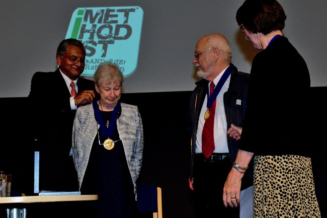 Dr. Hugh and Shirliann Johnson are given the World Methodist Peace Award Medals by World Methodist Council General Secretary Ivan Abrahams and Vice-President Gillian Kingston. Photo Credit: Sigmar Friedrich
