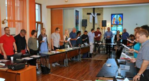 Participants in the European Methodist Council's September meeting in Ruse, Bulgaria, during devotions. Much of the meeting was devoted to a discussion of the current refugee crisis in Europe. (Photo by Üllas Tankler, UMNS)