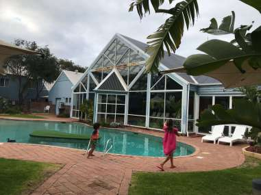 View of pool from outside, at Broadwater Resort
